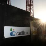 下載自路透 A logo is seen in front of cranes standing on a Carillion construction site in central London, Britain, January 16, 2018. REUTERS/Simon Dawson - RC18EED79E00