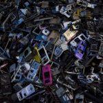 """達志影像不得重複使用!!! Old cellular phone components are discarded inside a workshop in the township of Guiyu in China's southern Guangdong province June 10, 2015. The town of Guiyu in the economic powerhouse of Guangdong province in China has long been known as one of the world's largest electronic waste dump sites. At its peak, some 5,000 workshops in the village recycle 15,000 tonnes of waste daily including hard drives, mobile phones, computer screens and computers shipped in from across the world. Many of the workers, however, work in poorly ventilated workshops with little protective gear, prying open discarded electronics with their bare hands. Plastic circuit boards are also melted down to salvage bits of valuable metals such as gold, copper and aluminum. As a result, large amounts of pollutants, heavy metals and chemicals are released into the rivers nearby, severely contaminating local water supplies, devastating farm harvests and damaging the health of residents. The stench of burnt plastic envelops the small town of Guiyu, while some rivers are black with industrial effluent. According to research conducted by Southern China's Shantou University, Guiyu's air and water is heavily contaminated by toxic metal particles. As a result, children living there have abnormally high levels of lead in their blood, the study found. While most of the e-waste was once imported into China and processed in Guiyu, much more of the discarded e-waste now comes from within China as the country grows in affluence. China now produces 6.1 million metric tonnes of e-waste a year, according to the Ministry of Industry and Information Technology, second only to the U.S with 7.2 million tonnes. REUTERS/Tyrone Siu   PICTURE 12 OF 18 FOR WIDER IMAGE STORY """"WORLD'S LARGEST ELECTRONIC WASTE DUMP"""" SEARCH """"GUIYU SIU"""" FOR ALL IMAGES   - RTX1IUQV"""