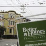 達志影像不得重複使用!!! A real state sign is seen near a row of homes in the Haight Ashbury neighborhood in San Francisco, California July 17, 2014. The median price for a single-family home or condominium rose to $1 million in June, according to a report released by DataQuick. REUTERS/Robert Galbraith  (UNITED STATES - Tags: REAL ESTATE BUSINESS SOCIETY) - RTR3Z4J1