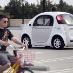 下載自路透 A Google employee on a bicycle acts as a real-life obstacle for a Google self-driving prototype car to react to during a media preview of Google's prototype autonomous vehicles in Mountain View, California September 29, 2015.  REUTERS/Elijah Nouvelage - RTS2BZN