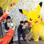 "下載自美聯社 Evacuee children pose with Pikachu during "" Pokemon with You Wagon,''  activity at a temporary housing unit of Matsuiwa Middle School, in Kesennuma, Miyagi Prefecture on March 10, 2013, ahead of the second anniversary of the Great East Japan Earthquake and  the ensuing tsunami on March 11, 2011. About 20 kids and parents took part in the event  and they were encouraged by the character. The wagon has visited more than 100  the make-shift housings since Feburaary last year.  ( The Yomiuri Shimbun via AP Images )"