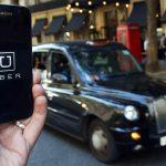 下載自路透 A photo illustration shows the Uber app logo displayed on a mobile telephone, as it is held up for a posed photograph in central London, Britain August 17, 2016.    REUTERS/Neil Hall/Illustration  - RTX2LJHT