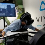 A visitor tries the flight simulator Birdly with a pair of HTC's Vive Virtual Reality (VR) goggles, during the annual Computex computer exhibition in Taipei, Taiwan June 1, 2016. REUTERS/Tyrone Siu - RTX2F33A