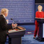 Republican U.S. presidential nominee Donald Trump speaks as Democratic U.S. presidential nominee Hillary Clinton listens during their first presidential debate at Hofstra University in Hempstead, New York, U.S., September 26, 2016.     REUTERS/Rick Wilking - RTSPKDV