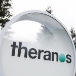 下載自美聯社 A logo sign outside of the headquarters of Theranos in Palo Alto, California on January 24, 2016. Photo by Kristoffer Tripplaar *** Please Use Credit from Credit Field ***