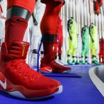 Basketball Jerseys and footwear for different countries made by Nike are displayed during an unveiling event in New York, March 17, 2016. REUTERS/Eduardo Munoz  - RTSAZJN