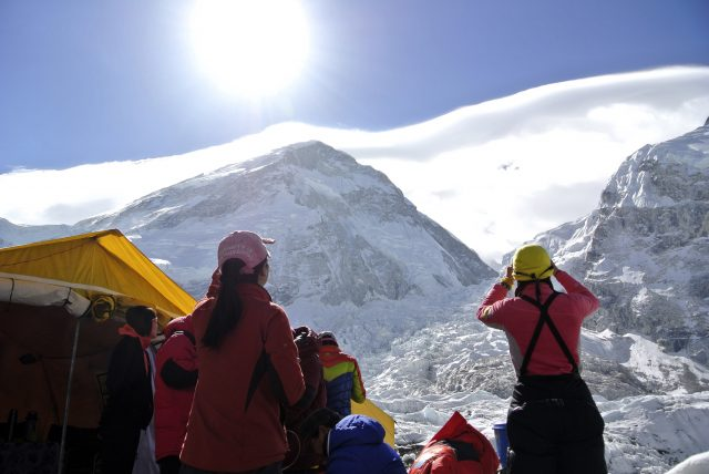 Climbers who are unable to scale Mount Everest look up towards the avalanche site at Khumbu Icefall after their expedition was cancelled in Solukhumbu district April 27, 2014. There was fury among the roughly 400 sherpas at base camp after the April 18 accident on the perilous Khumbu icefall, the single deadliest disaster on the world