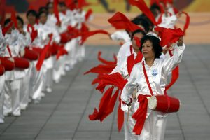 Performers dance with drums ahead of IOC's announcement of the winner city for the 2022 winter Olympics bid, outside the Birds' Nest, also known as the National Stadium, in Beijing, China, July 31, 2015. Beijing officials on Friday highlighted the nation's ability to deliver on promises as the Chinese capital, the frontrunner in the race, made its final pitch to the International Olympic Committee on Friday. REUTERS/Damir Sagolj - RTX1MIM7